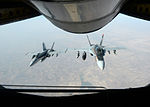 US Navy F-18E Super Hornets supporting operations against ISIL 141004-F-FT438-136.jpg