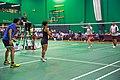 US Senior International Badminton Tourney (Miami) - XD 35 - Andy & Hellena def David & Evi 11 & 13 - Hellena serving (16648302241).jpg