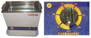 Ultrasonic cleaning - Ultrasonic cleaner showing the removable basket in place, and a closeup of the light and timer