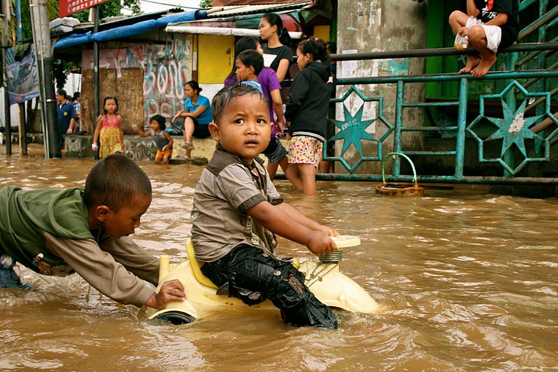 File:VOA Children play in flood waters after torrential rains in Kampung Melayu.jpg