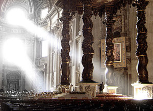 St. Peter's Baldachin - The old Solomonic columns mounted above the balcony (upper right background, against the wall)