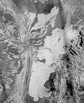 Geology of Venus - Lava originating from Ammavaru caldera (300 km outside the image) overflowed the ridge left of center and pooled to its right.