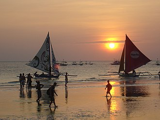 Paraw - Paraw sailboats in Boracay with traditional Austronesian crab claw sails