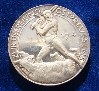 Russian invasion of East Prussia (1914) - WWI German Silver medal East Prussia 1914. The naked General Hindenburg fighting the Russian Bear with his sword. Reverse