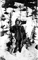 Woman dressed in furs with a dog in the snow, probably Yukon Territory, circa 1898 (AL+CA 1248).jpg