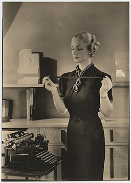 Woman holding typewriter ribbon at Royal Typewriter (7009492745)