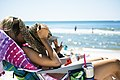 Woman with Sunglasses and hat at Panama City beach (Unsplash).jpg