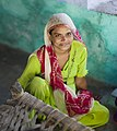 Woman with a green dress and a scarf, Rajasthan (6358520093).jpg