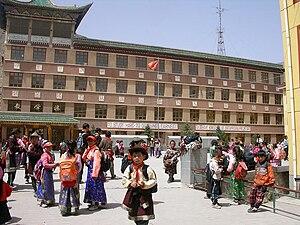 Xiahe County - Xiahe school (note mottos in English, Chinese, and Tibetan)