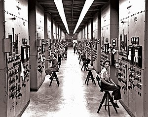 Y-12 National Security Complex - Employees of the Manhattan Project operating calutron control panels at Y-12, in a US government photo by Ed Westcott.