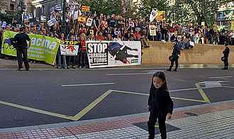 Animalist Party Against Mistreatment of Animals - Anti-bullfight manifestation in Zaragoza that shows some people carrying a banner of PACMA