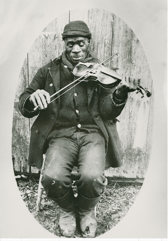 %27Joe Izzard playing the fiddle. Nova Scotia Archives