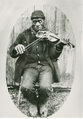 'Joe Izzard playing the fiddle. Nova Scotia Archives.png