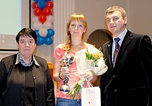 Hand-over of the Caissa Chess Award to Nadezhda Kosintseva by Nona Gaprindashvili and Igor Lobortas