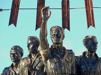 Onésimo Redondo - Representation of Redondo (in the center, with arm raised) in a monument erected to his memory (which has been demolished in compliance with the Historical Memory Law)