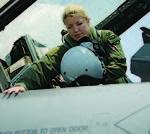 060708-F-6699G-004 USAF Female F-16 Pilot 1st Lt. Sarah Eccles enters the cockpit of her aircraft.JPG