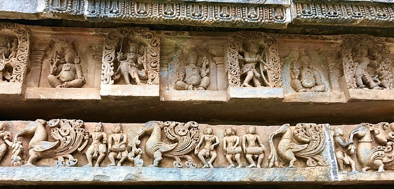 File:12th-century Kama Artha Dharma Moksha relief at Shaivism Hindu temple Hoysaleswara arts Halebidu Karnataka India 5, lower panel shows musicians and dancing peacocks.jpg