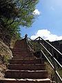 131 Sant Miquel del Fai, escala que baixa a la cova.JPG