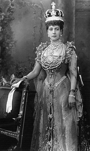 Crown of Queen Alexandra - Queen Alexandra wearing her crown. The European-style crown contained more half arches than was usual in British crowns, and had its cap placed lower, allowing a clear view through the crown.