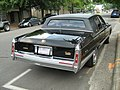 1991 Cadillac Fleetwood gold-edition black rr.jpg