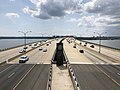 2019-07-04 15 05 49 View south along Interstate 95 and Interstate 495 (Capital Beltway) crossing the Potomac River via the Woodrow Wilson Bridge from the pedestrian overpass for the Woodrow Wilson Bridge Trail in National Harbor, Maryland.jpg