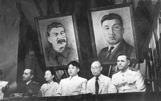Kim Il-sung - Kim Il-sung (centre) and Kim Tu-bong (second from right) at the joint meeting of the New People's Party and the Workers' Party of Korea in Pyongyang, 1946.
