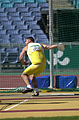 291000 - Athletics field discus F12 Russell Short gold action 2 - 3b - 2000 Sydney event photo.jpg