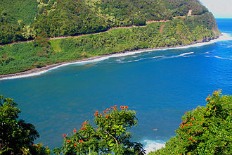 Hana Highway - The highway hugs the mountainside around an inlet