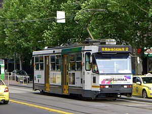 Melbourne tram route 12 - A class tram on Collins Street in December 2014