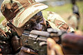 A Benin soldier sights in during a weapons handling class as part of Africa Partnership Station (APS) in Benin Oct. 9, 2013 131009-M-PE262-002.jpg