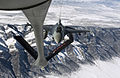 A U.S. Air Force pilot maneuvers his F-16CG Fighting Falcon into position behind the refueling boom of a KC-135 Stratotanker to receive fuel during a training mission over Utah 130118-F-IG195-559.jpg
