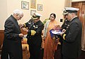 A delegation of Kendriya Sainik Board pinning a flag on the Vice President, Shri Mohd. Hamid Ansari, during the Armed Forces Flag Day, in New Delhi on December 05, 2014.jpg