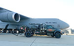 A fuel truck is staged as U.S. Airmen assigned to the 436th Logistics Readiness Squadron conduct a refueling operation with a C-5 Galaxy aircraft at Dover Air Force Base, Del., Oct. 2, 2013 131002-F-VV898-017.jpg