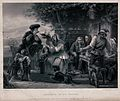 A group of people are gathered around a table outside a cott Wellcome V0040372.jpg