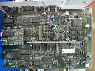 Acorn Archimedes - Acorn Archimedes A3000 main PCB. Corrosion from a leaky NiCd battery can be seen in the bottom left corner.