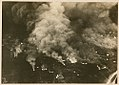 Aerial view of a burning munitions factory (9417519958).jpg