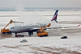 Deicing - An Aeroflot Airbus A330 being de-iced at Sheremetyevo International Airport.