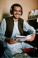 Afghan journalist Qudratulla Samin smiles for a photo while broadcasting from the temporary facilities of the Tarin Kowt Radio and Television Station in Tarin Kowt, Uruzgan province, Afghanistan, May 30, 2013 130530-O-MD709-052.jpg