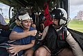 "Aircrewman ""fist bumps"" an evacuee on an MH-60S Sea Hawk helicopter (37279186202).jpg"