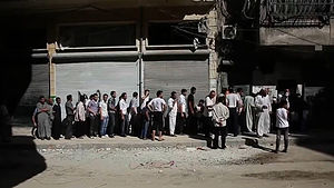 Battle of Aleppo (2012–2016) - Aleppians waiting in a bread line during the Syrian civil war