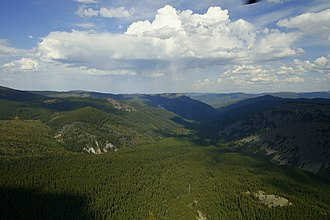 Summit accordance - The highest of hills in this picture show fairly similar heights making up a summit accordance. Aerial photograph from the Altai region of Russia.