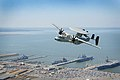 An E-2D Hawkeye flies over Naval Base Norfolk (13315193084).jpg
