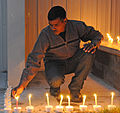 An Indian Army soldier lights a candle during a Diwali festival celebrated with Soldiers from the U.S. Army Alaska at the Wilderness Inn dining facility on Joint Base Elmendorf-Richardson, Alaska in 2010.jpg