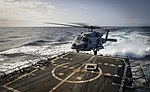An MH-60R Sea Hawk helicopter takes off from the flight deck of USS Oscar Austin. (35988351413).jpg
