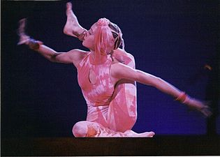 An acrobat performing in the contortion act of Cirque du Soleil's Nouvelle Experience, 1994.jpg