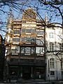 Ancien magasin Old England through the trees.jpg