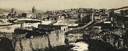 Armenian quarters of city of Shusha destroyed by Azerbaijani armed forces in 1920 with defiled cathedral of Holy Savior on background 2.jpg