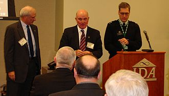 Army Science Board - Secretary of the Army Dr. Francis J. Harvey (center), a former ASB member, awards the Decoration for Distinguished Civilian Service to departing ASB Chair Dr. James Tegnelia (left) as ASB Executive Secretary LTC Scott S. Haraburda (right) reads the citation, Feb. 24, 2005. (Photo courtesy of ASB Photo Archives)