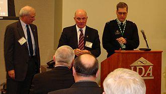Scott Haraburda - Army Secretary Harvey (center) presents an award to Dr. Tegnelia (left) as LTC Haraburda (right) reads the citation in 2005. (ASB Photo Archives.)
