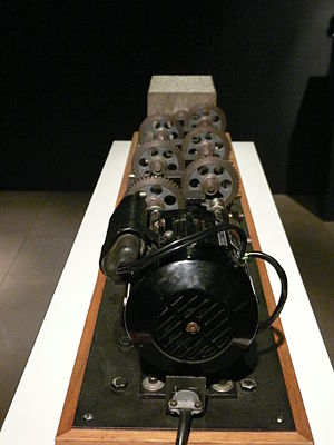 Arthur Ganson - Machine with Concrete. The gear reductions mean the final gear will make one revolution in over 2 trillion years. The machine runs uninterrupted even though the final gear is embedded in concrete, and cannot rotate.
